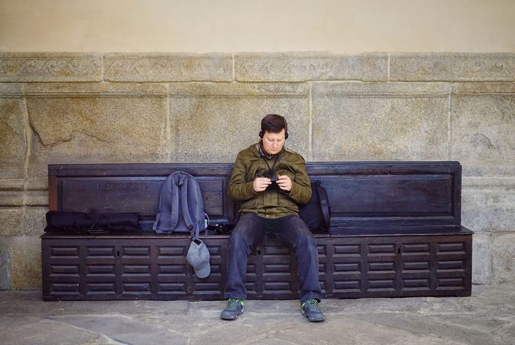 Listening Listening To Music Toledo Toledo Spain Cathedral One Person Tourism Tourist Relaxing Symmetrical Headphones Backpack One Man Only Portrait Full Length Sitting Men Front View Casual Clothing Shoe Footwear Human Leg Wearing Warm Clothing Posing Analogue Sound