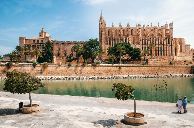 Palma Cathedral And Royal Palace Of La Almudaina By River