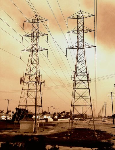 Electricity  Power Line  Power Supply Electricity Pylon Connection Cable No People Outdoors Romantic Sky Sky Dramatic Sky Day Sunset Colors Communication Cloudy Cold Temperature Huntington Beach Safety Santaanariverbed Atmospheric Mood Scenics