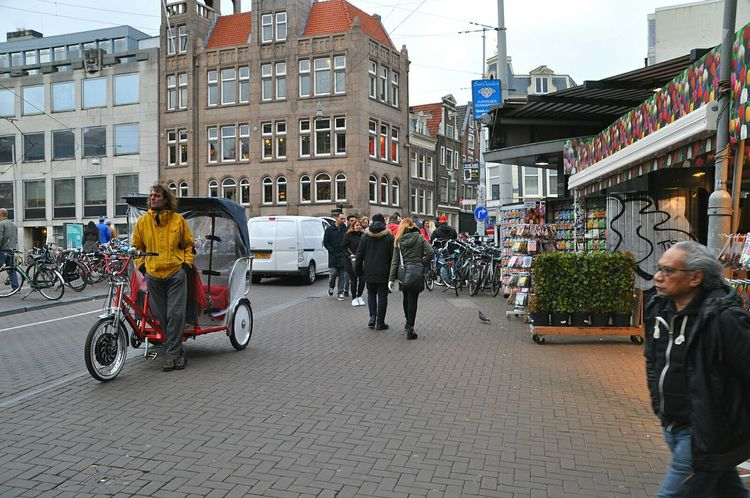 The flower market with a bicycle taxi in amsterdam city Your Amsterdam Flower Market City Of Amsterdam Netherlands City Life Symbol Of Amsterdam Typical Amsterdam Canals Of Amsterdam My Hometown Old Amsterdam City My Amsterdam Amsterdam Amsterdamcity Homeless Transportation Welcome To My World Bicycle Taxi Canal Houses