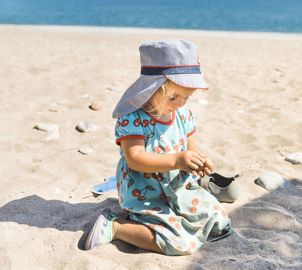 Midsection of child on beach