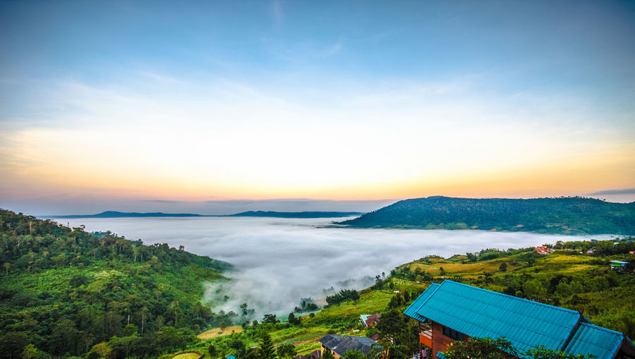 Khao Kho is a beautiful place. Me and the family are very happy. Sky Scenics - Nature Beauty In Nature Cloud - Sky Tranquil Scene Tranquility Nature Plant Environment Sunset Tree Mountain Landscape No People Idyllic High Angle View Non-urban Scene Land Green Color Outdoors Sun