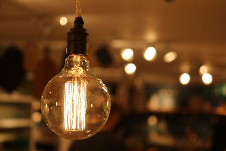 Close-Up Of Illuminated Light Bulb With Filament