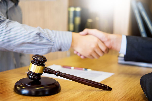 Lawyer Adult Business Business Person Choice Close-up Courthouse Decisions Focus On Foreground Hand Handshake Human Body Part Human Hand Indoors  Justice - Concept Law Legal System Legal Trial Men Occupation Office People Table