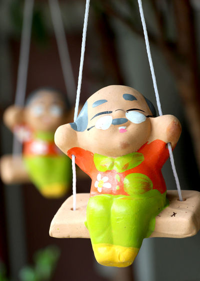Focus On Foreground Human Representation Close-up No People Arts Culture And Entertainment Indoors  Drink Hanging Day Freshness Simple Health Relax Happiness Happy Baked Clay Swing Ceramic Doll Ceramic Color Colorful Clay Doll Clay Toy Old