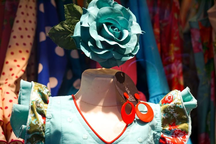Close-up of artificial turquoise flower on mannequin in store