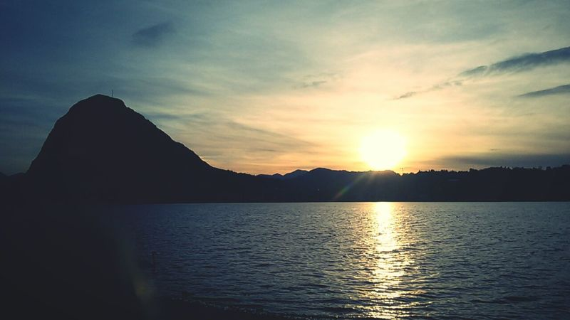 Switzerland Swiss Lugano, Switzerland Luganolake Lugano Lago Di Lugano  Sunset #sun #clouds #skylovers #sky #nature #beautifulinnature #naturalbeauty Photography Landscape [ Light Light And Shadow