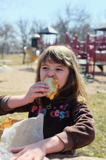 Girl eating food at playground