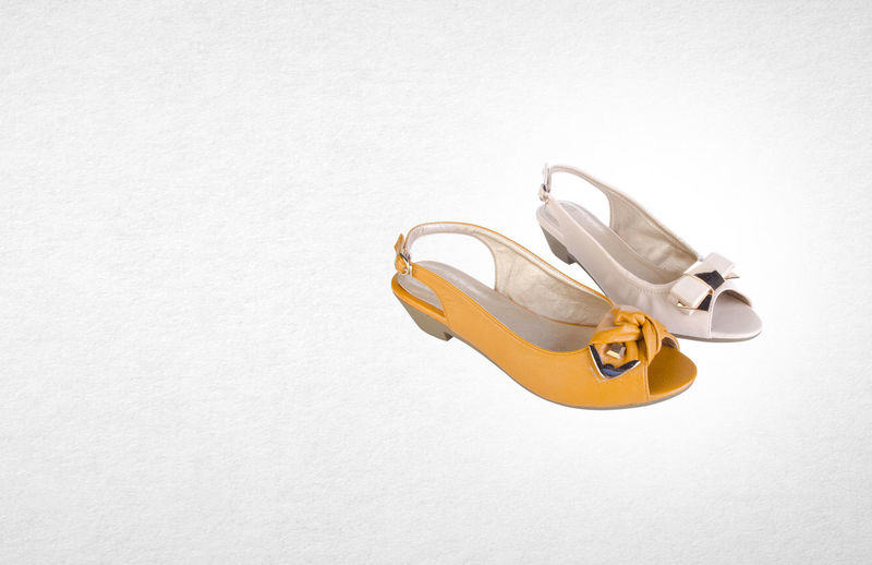 High angle view of shoes against white background
