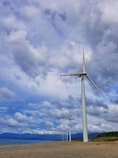 Bangui wind turbines that produce electricity Sky Clouds Windmill Wind Turbine Wind Power Technology Sea Power In Nature Beach Rural Scene Alternative Energy Electricity  Power Supply