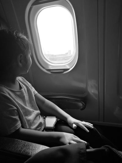 Window Sitting Adults Only Vehicle Interior Indoors  One Person Adult Only Women One Woman Only Airplane Human Body Part People Day Human Hand Eyeem Philippines EyeEmBestPics Airplaine Welcome To Black