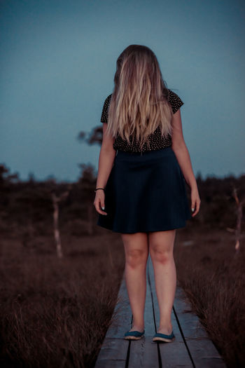 Scay horror movie girl standing in the bog at night Evil Film Adult Clothing Demon Dress Fantasy Full Length Hair Horizon Over Water Land Long Hair Mistery Movıe Nature One Person Real People Rear View Scary Sky Standing Women