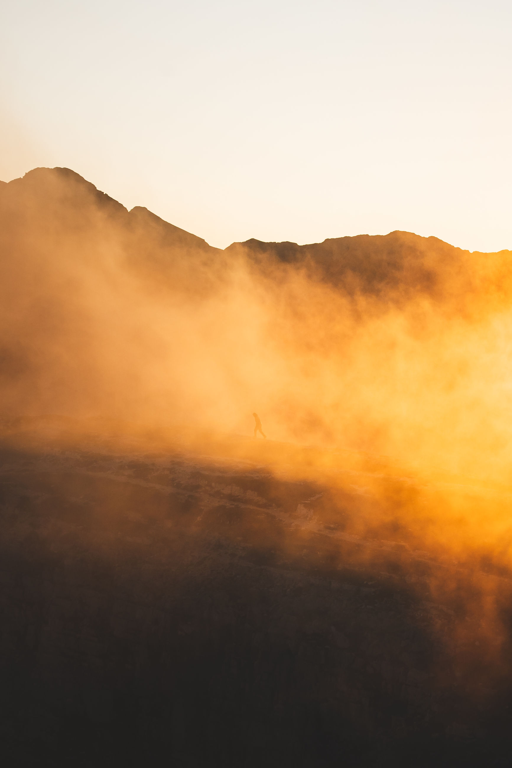 sky, beauty in nature, scenics - nature, orange color, tranquil scene, nature, tranquility, sunset, mountain, silhouette, environment, non-urban scene, idyllic, no people, cloud - sky, landscape, outdoors, copy space, vertebrate, geology