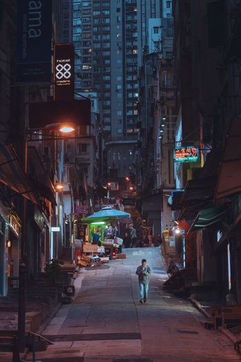 Hong Kong Central Hong Kong 中環 One Person Architecture City Building Exterior Built Structure Illuminated Night Street City Life Incidental People Transportation EyeEm Best Shots EyeEm Selects EyeEm Gallery Building Real People Walking People Residential District Market Lifestyles Full Length Outdoors Skyscraper Office Building Exterior Streetwise Photography