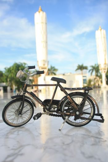 Transportation Bicycle Architecture Mode Of Transportation Land Vehicle Built Structure Nature Day No People Outdoors Sky Building Exterior Focus On Foreground Cloud - Sky Travel Building Architectural Column Stationary City Sunlight Wheel Aceh