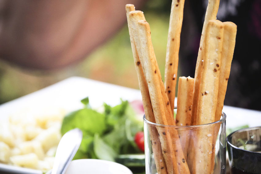 Breadsticks with dinner. Food And Drink Lunch Snack Appetizer Baked Bread Breadsticks Cooked Eat Food Food And Drink Fresh Freshness Gourmet Grissini Healthy Eating Italian Nutrition Ready-to-eat Restaurant Snack Sticks Table Tablecloth Tasty