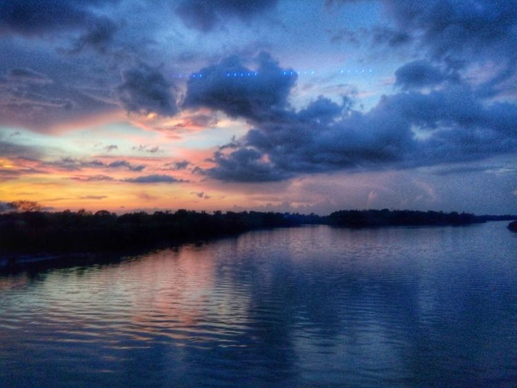 The calm before the storm Dusk Dramatic Sky Sunset Sunset_collection Reflection Water Water Reflections Smartphonephotography Tranquil Scene Beauty In Nature Cloud - Sky Tranquility Nature No People Waterfront Lake