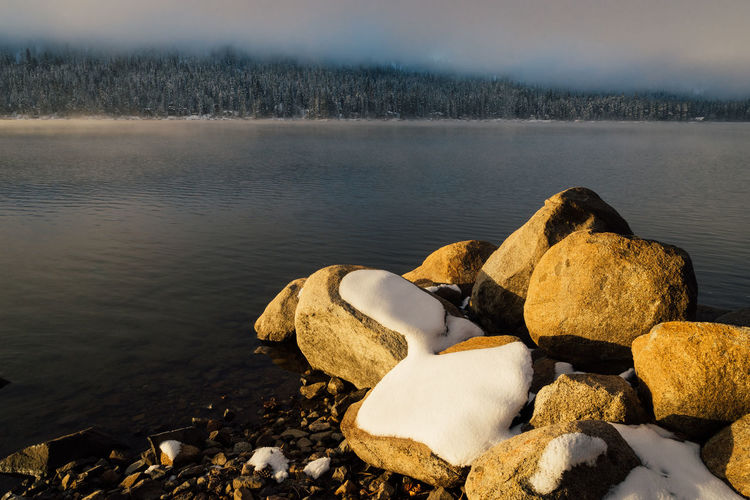 Winter sunrise at Donner Lake, California. California Donner Lake Rocky Truckee  Beauty In Nature Day Lake Nature No People Outdoors Pebble Pebble Beach Rock - Object Scenics Ski Snow Sunrise Tranquil Scene Tranquility Water