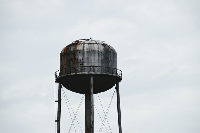 road trippin,water tower Storage Tank Sky Low Angle View Metal Architecture Rusty No People Cloud - Sky Outdoors Day Tank Industry Neglected Rustic Low Angle View South Louisiana Exteriorphotography Industrial Photography Architecture Cloud And Sky