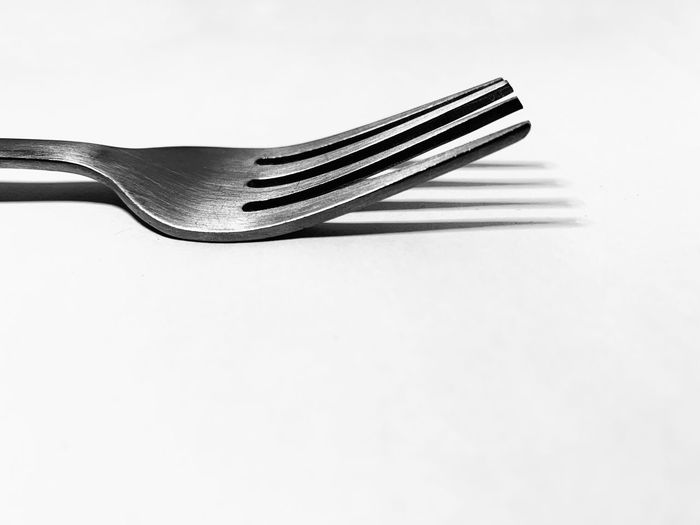 White Background Studio Shot Copy Space Indoors  Single Object Metal Still Life Close-up No People Kitchen Utensil High Angle View Eating Utensil Fork Stainless Steel  Steel Silver Colored Household Equipment