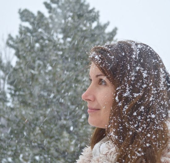 Beautiful snow storm Profile Woman Woman's Face Beautiful Woman Brunette Women Cold Winter Fashion Faux Fur Coat And Scarf Wearing Holiday Collection Holiday Season Concepts And Images Mature Adult Outside Its A Winter Wonderland Model In Snow Nature Outdoors Outdoors Photograpghy  People Or Person Out In The Snow Pine Christmas Tree In Background Seasonal Cold Winter Day Smiling Snow Snow Scene  Snow Storm Looking At Snow Falling With Snow Flakes In Her Hair Snowing Weather Winter Women