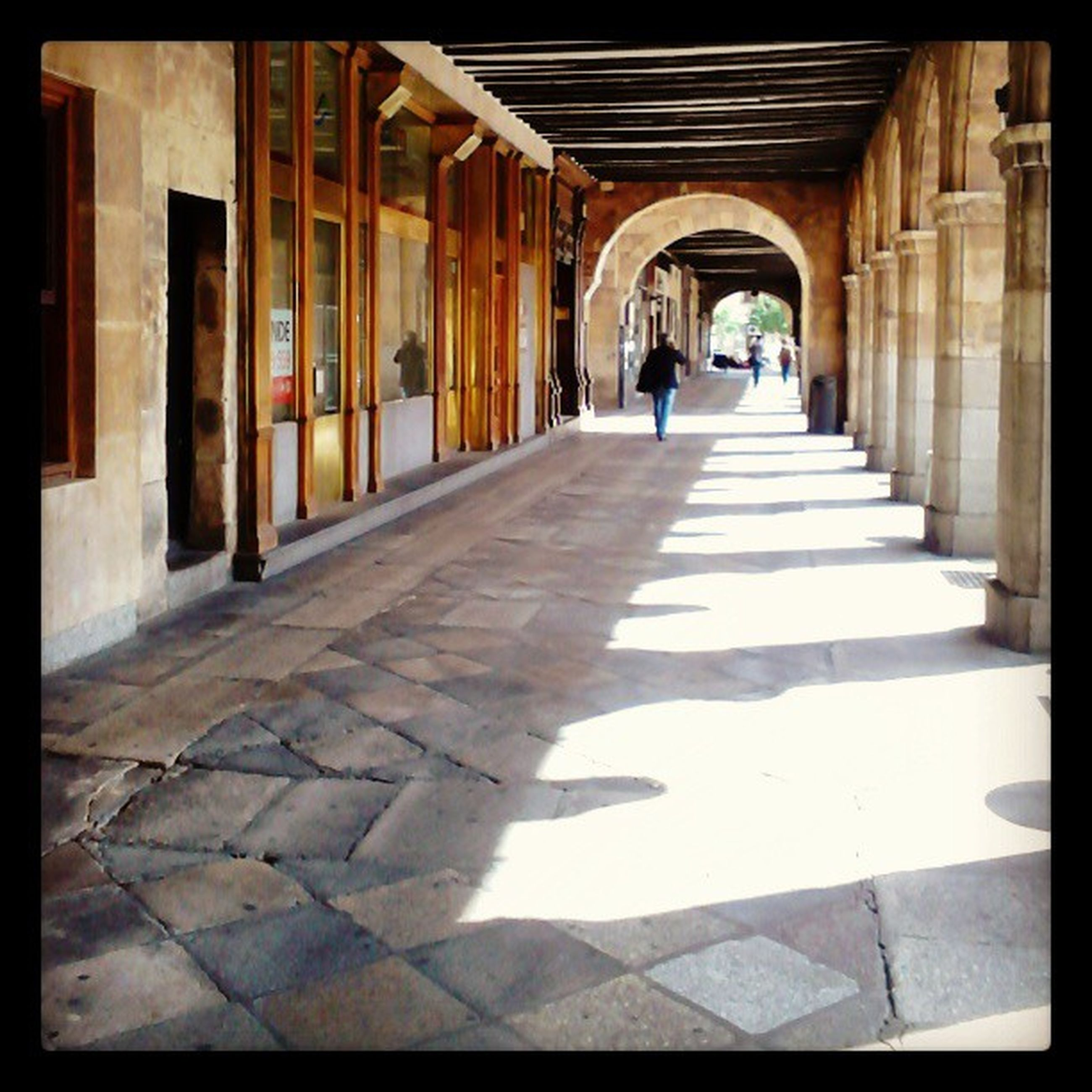 architecture, built structure, the way forward, diminishing perspective, indoors, corridor, building exterior, architectural column, empty, tiled floor, column, transfer print, building, in a row, vanishing point, flooring, colonnade, sunlight, shadow, walkway