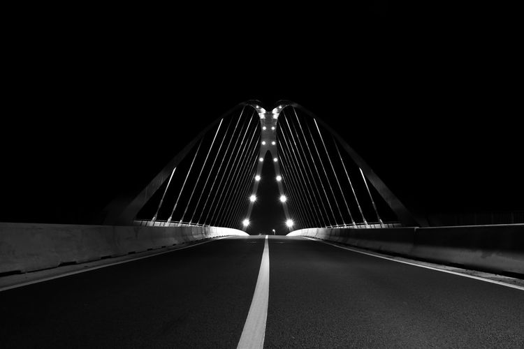 Illuminated road bridge at night