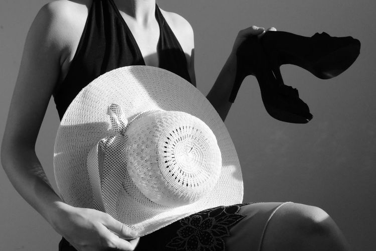 Blackandwhite Black And White Dress Dressing Up Whitehat Hat Shoe HIGH HEALS Heals Black Dress One Person Women Adult Holding Lifestyles Casual Clothing Close-up Studio Shot Front View Clothing Indoors  Real People Human Body Part