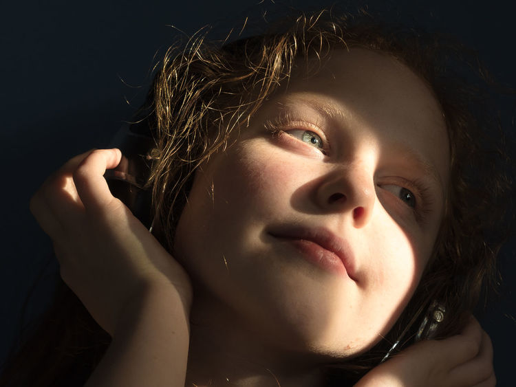 Black Background Child In Sun Child Portrait Childhood Memories Close-up Closeup Day Dramatic Lighting Evening Light Eyes Girl Girl Smiling Headphones Kid Smiling Kids Being Kids Kids Having Fun One Person People Portrait Pretty Eyes Real People Studio Shot Warm Light Young Adult Young Women