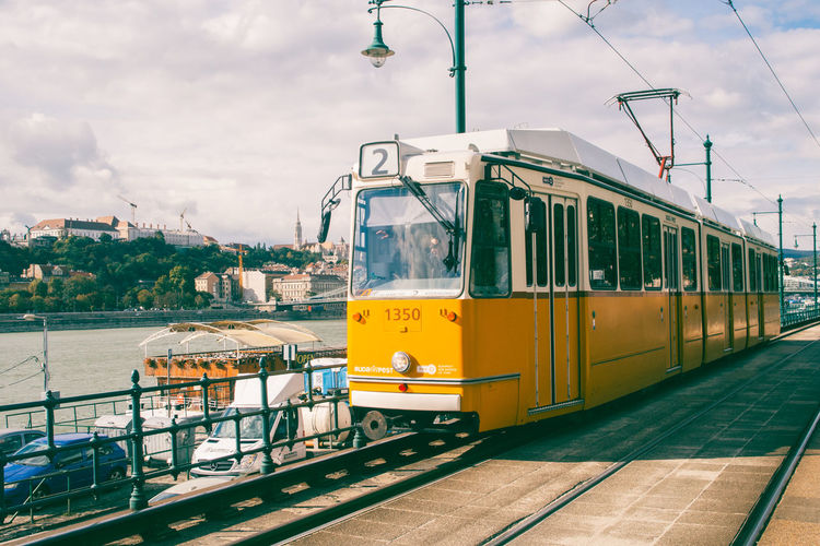 Tram in Budapest on riverside of Danube Budapest Built Structure City Danube Day Euroespresso Europe Explore Exploring Holiday Mode Of Transport Movement Outdoors Public Transportation Rail Railroad Track Relaxing River Side View Sky Train Tram Transportation Travel Way It's About The Journey