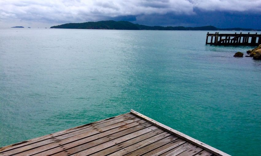 Water Sky Wood - Material Built Structure Cloud - Sky Sea Outdoors Pier Day Nature Architecture Beauty In Nature Scenics Building Exterior Mountain Jetty Vacations Lifestyles No People