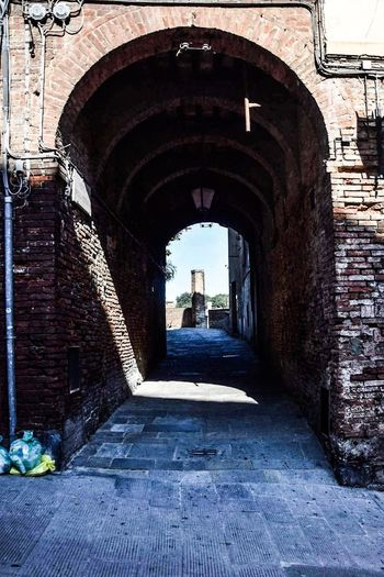 Built Structure Architecture Arch The Way Forward Wall - Building Feature Old Brick Wall Building Exterior Narrow Footpath Paving Stone Stone Wall History Diminishing Perspective The Past Day Walkway Damaged Archway Pathway