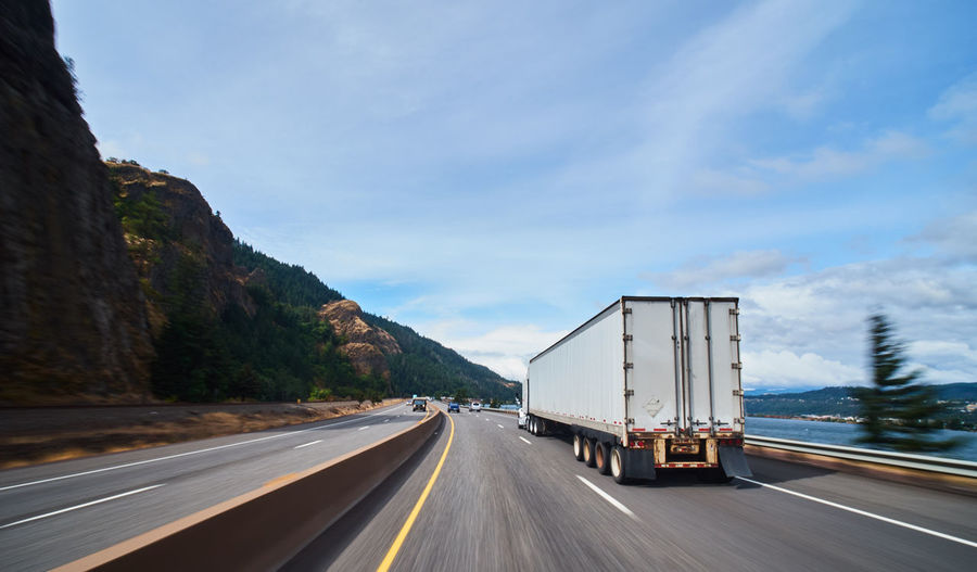 Transportation Road Sky Mode Of Transportation Land Vehicle Truck Motion Mountain Nature The Way Forward Semi-truck Cloud - Sky Motor Vehicle on the move Freight Transportation No People Day Highway Symbol Sign Outdoors