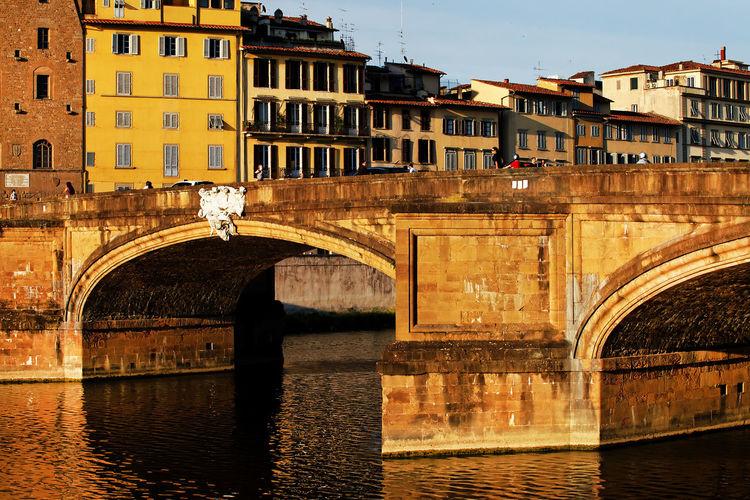 Ponte Santa Trinita Over Arno River In Tuscany Against Sky