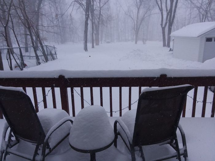 Empty chair on snow covered landscape during winter