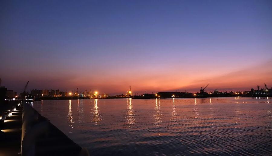 Kaohsiung port after sunset at dusk Water Sky Sunset Waterfront Port Outdoors Transportation Harbor Logistics Blue Hour Dusk Reflection Cranes Harbor Cranes Pier Kaohsiung Harbor Taiwan