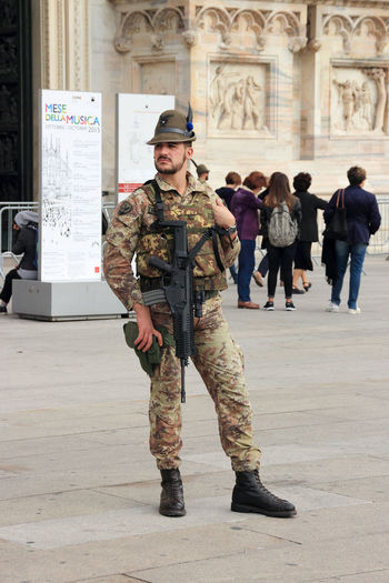 Milan, Italy, 29 September 2015,National Guard near Milan Cathedral Gun Milan Cathedral Milan,Italy National Guard Safeguard Security Soldier Square Travel Architecture Army Army Soldier Camouflage Clothing Day Europe Military Uniform Minster Outdoors People Protection Religion Standing Tourism Watch Weapon