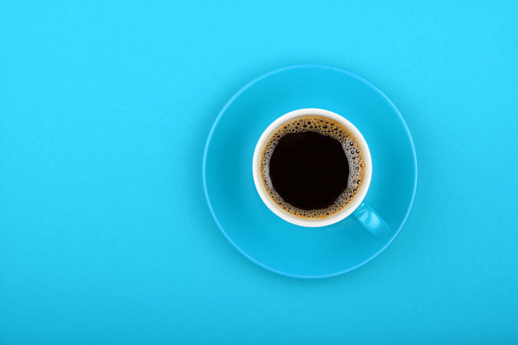 Black decaf americano coffee over blue background, top view Americano Americano Coffee Black Blue Close-up Coffee Coffee - Drink Coffee Break Coffee Cup Coffee Time Day Decaf Decaf Coffee Drink Food Food And Drink Freshness Healthy Eating Natural No People Organic Refreshment Studio Shot Table Top View Food Stories