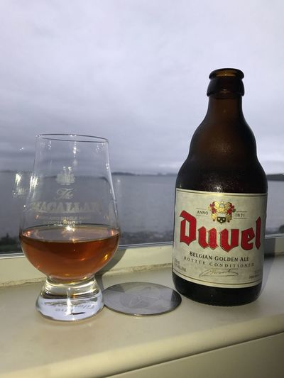 Nice day to travel thru Scotland and Belgium Sky And Clouds sky Drinking Glass Bottle Drink Water No People Alcohol Beer Scotch Whisky Scotland Duvel Belgium Belgium Beer skyline Bridge