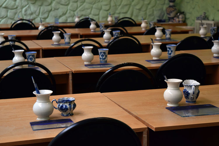 Close-Up Of Crockery On Table Arranged In Restaurant