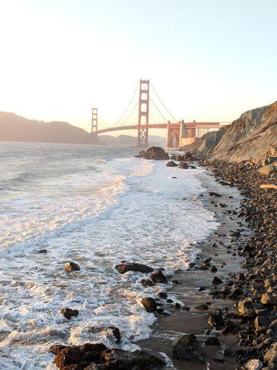 Golden Hour SanFranciscoBay California Golden Hour Golden Gate Bridge EyeEm Selects City Urban Skyline Cityscape Suspension Bridge Water Bridge - Man Made Structure Beach Winter Business Finance And Industry Sky
