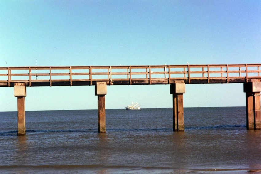Film Ocean View Oceanside Architecture Blue Boat Bridge - Man Made Structure Built Structure Clear Sky Connection Day Dock Film Photography Filmisnotdead Fishing Nature No People Ocean Outdoors Port Sea Sky Water Water_collection Waterfront