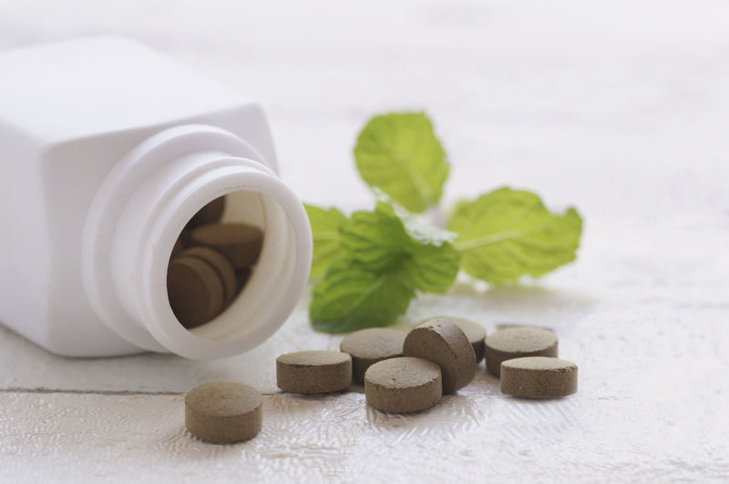Close-up of herbal medicines on table