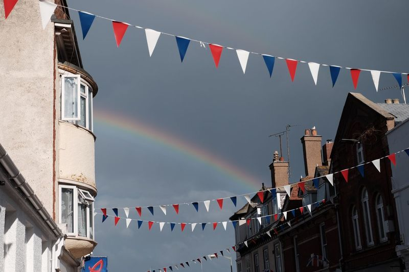 Nature's bunting EyeEm Best Shots Festive Summer EyeEm Selects Built Structure Building Exterior Architecture Flag Bunting Multi Colored Patriotism Sky Rainbow Decoration Hanging Nature Outdoors