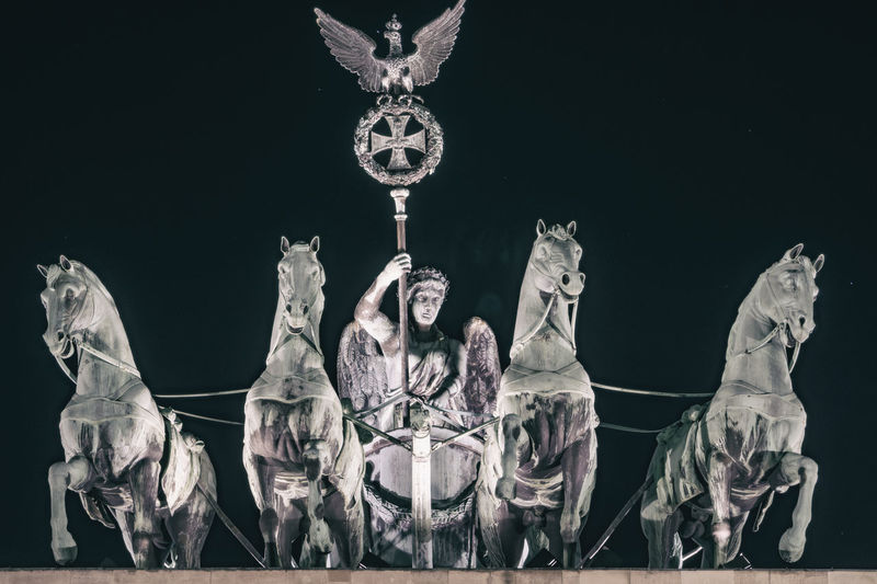 Close-Up of Quadriga on Top of Brandenburg Gate at Night Berlin Germany 🇩🇪 Deutschland Color Image Outdoors No People Horizontal Brandenburg Gate Quadriga Night Close-up Representation Art And Craft Human Representation Sculpture Creativity Male Likeness Statue Architecture History The Past Built Structure Animal Representation Illuminated Low Angle View Black Background