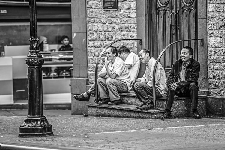"""""""Small Break Outside of the Church"""" NYC Street Photography NYC Photography NYC NYC Street Chinatown Manhattan New York City Adult Adults Only Architecture Building Exterior City Day Full Length Men Only Men Outdoors People Real People Sitting Two People Stories From The City The Street Photographer - 2018 EyeEm Awards My Best Photo"""