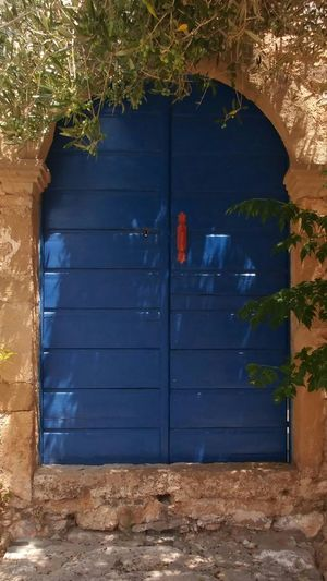 the blue door of Monevasia. Travel Greece Blue