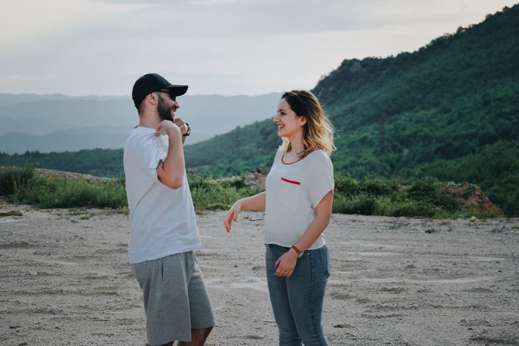 Young couple standing on land