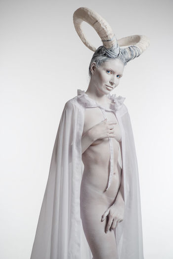 Female with goat body-art isolated on white. Dedicated to Chinese Horoscope 2015 - Year of the Goat (Sheep) Aries Goat Horned Woman Horns Horoscope  Looking At Camera Woman Zodiac Sign Astrology Sign Beautiful People Beautiful Woman Body Paint Bodyart Character Cloak Conceptual Female Horned Isolated White Background Naked_art Sheep Studio Shot White Background Women Young Adult