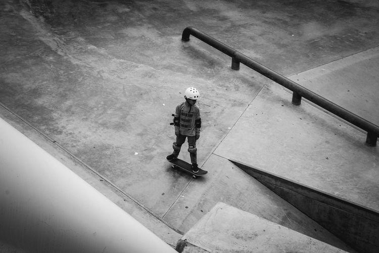Full Length Of Boy Skateboarding At Park